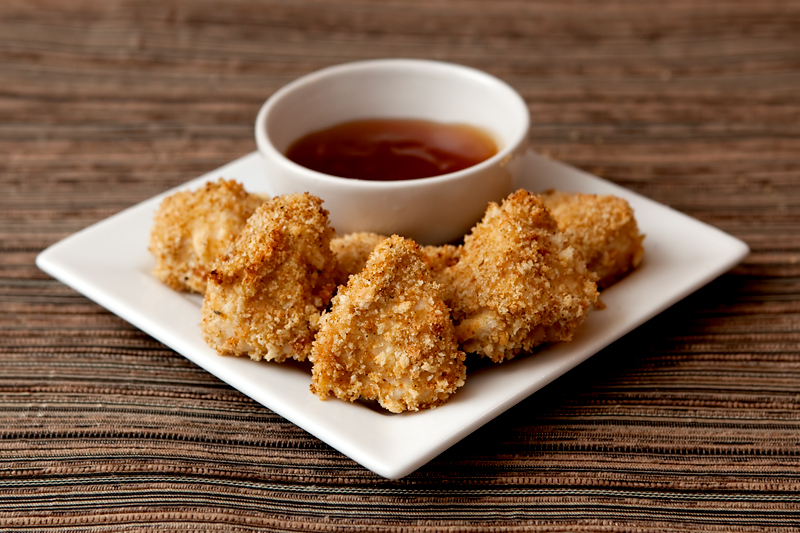 Homemade healthy chicken nuggets with a tangy sweet and sour sauce