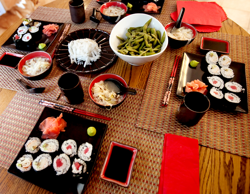 Homemade sushi spread on table.