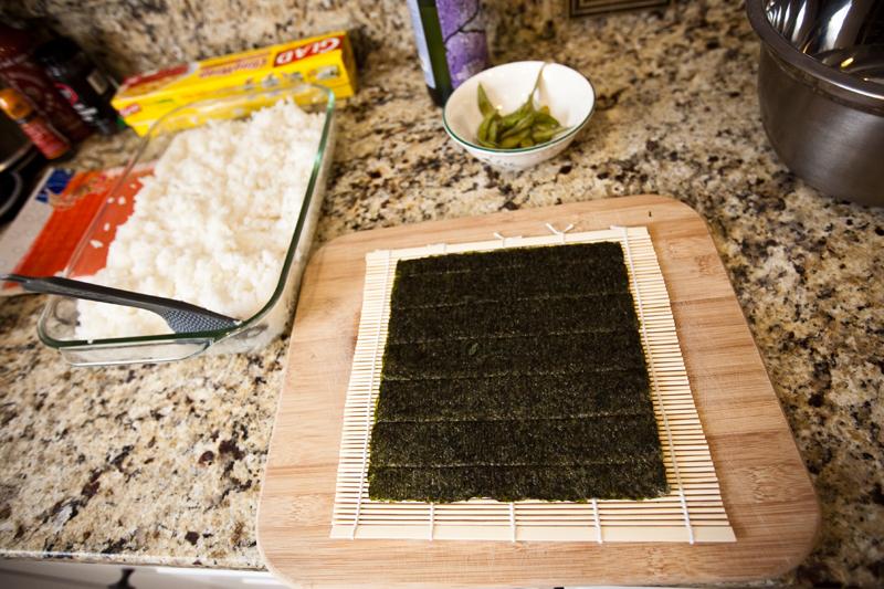 Sushi rice and Nori on bamboo sheet.