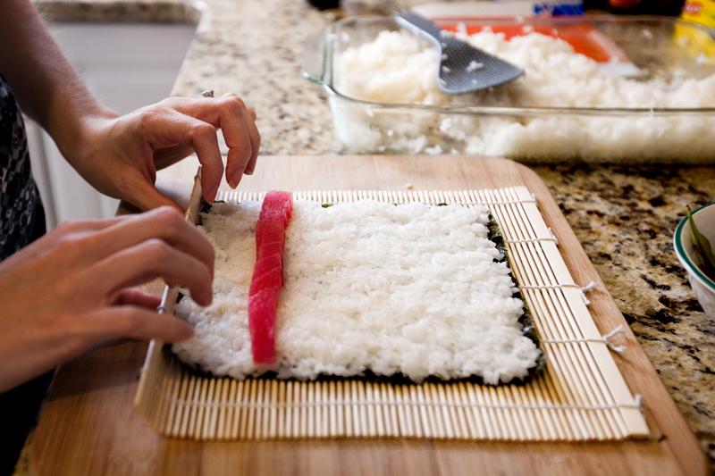 Rolling a homemade tuna roll