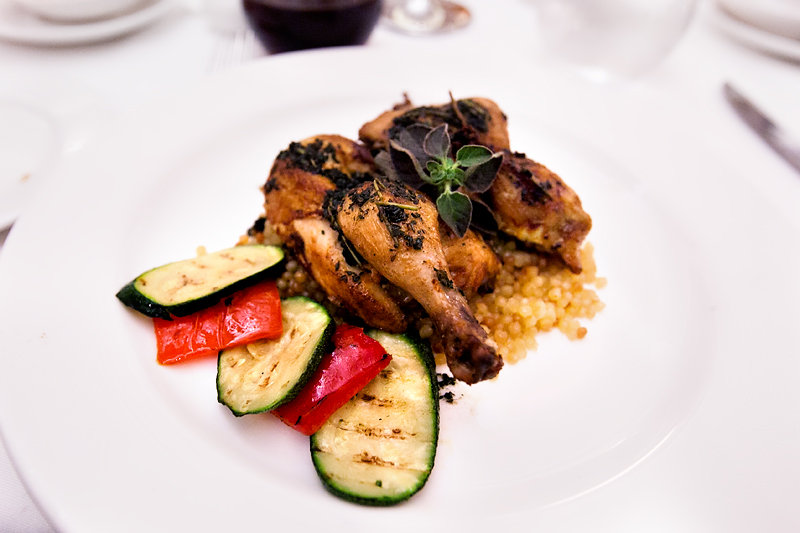 roasted half cornish hen with couscous on a Disney cruise