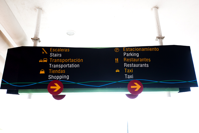 english spanish signs in cozumel