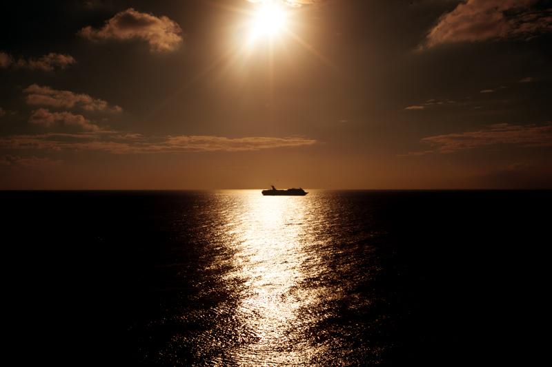 sunset cruise ship silhouette