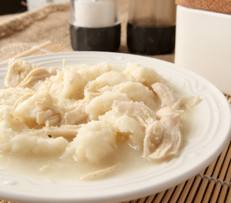A dish of creamy chicken and dumplings