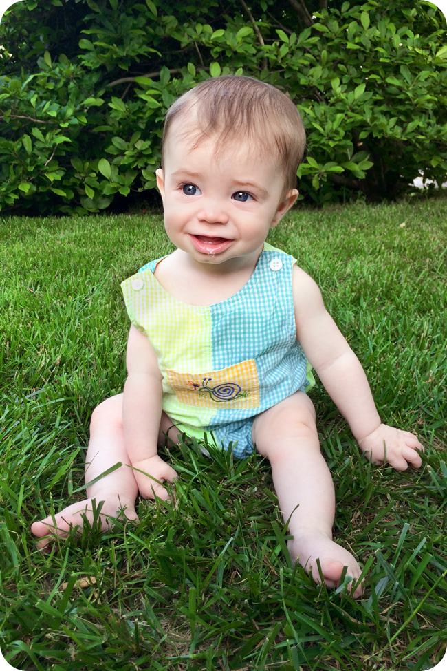 6-month-old-sitting-up-in-grass