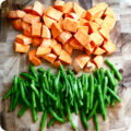 sweet-potatoes-and-green-beans-on-cutting-board