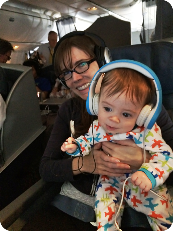 dj-babyroo-with-headphones-on-airplane