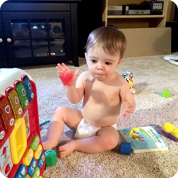 baby-playing-with-vtech-alphabet-letter-block