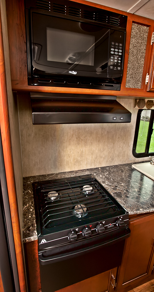 microwave stove and oven in passport travel trailer