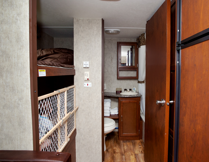 bunks and bathroom in passport travel trailer