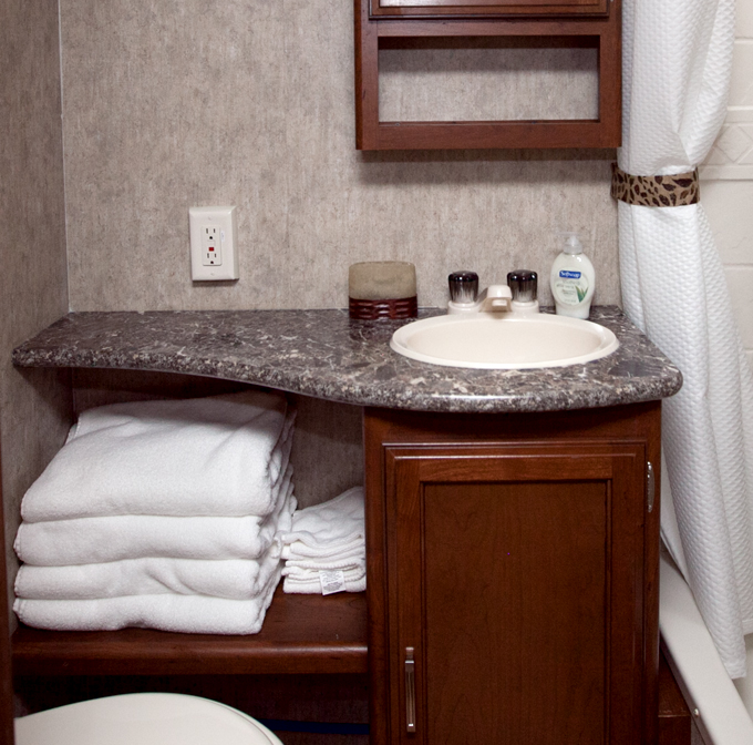 bathroom sink and towel shelf in passport ultra lite trailer