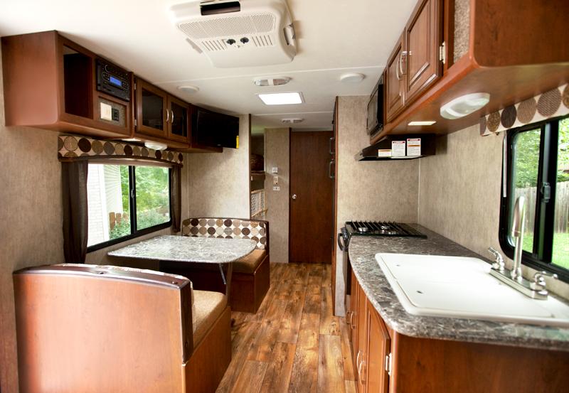 dinette and kitchen in passport ultra lite trailer