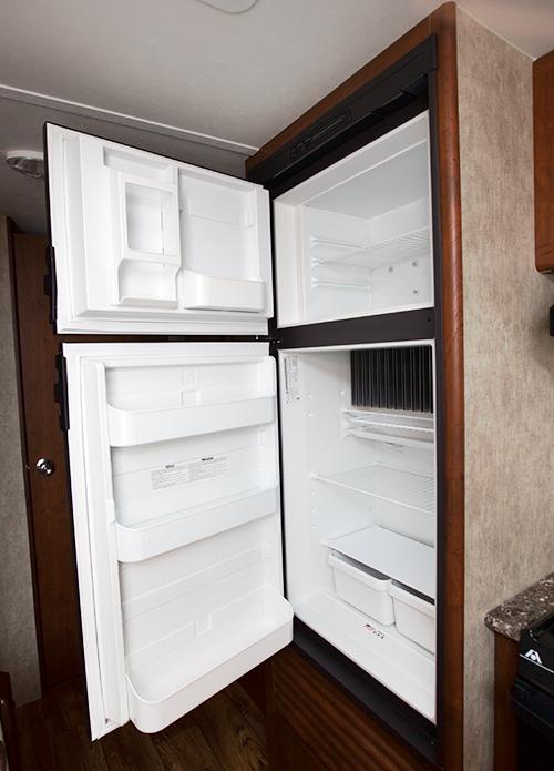 refrigerator in passport ultra lite trailer