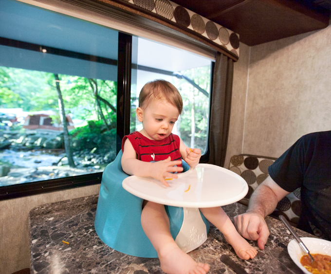baby-eating-in-bumbo-in-camper