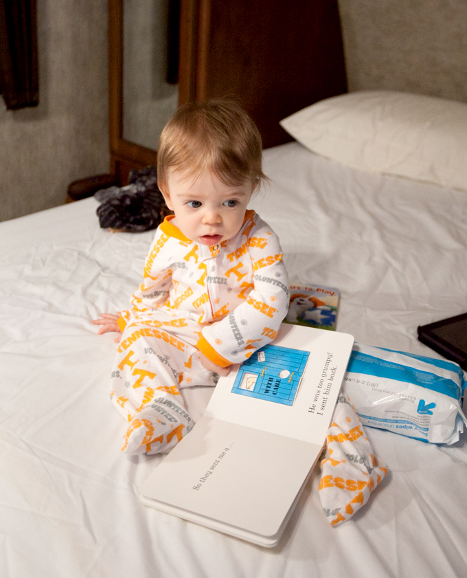 baby-reading-dear-zoo-on-camper-bed