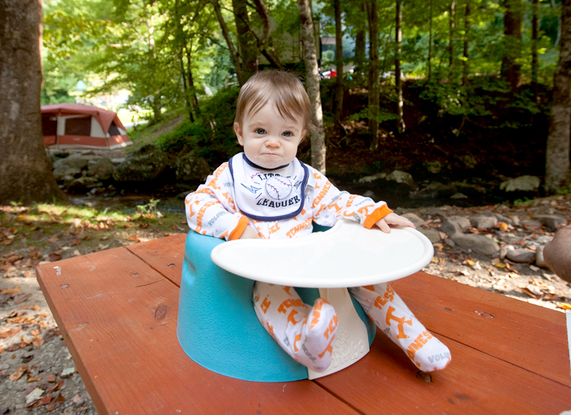 baby-sitting-in-bumbo-on-picnic-table