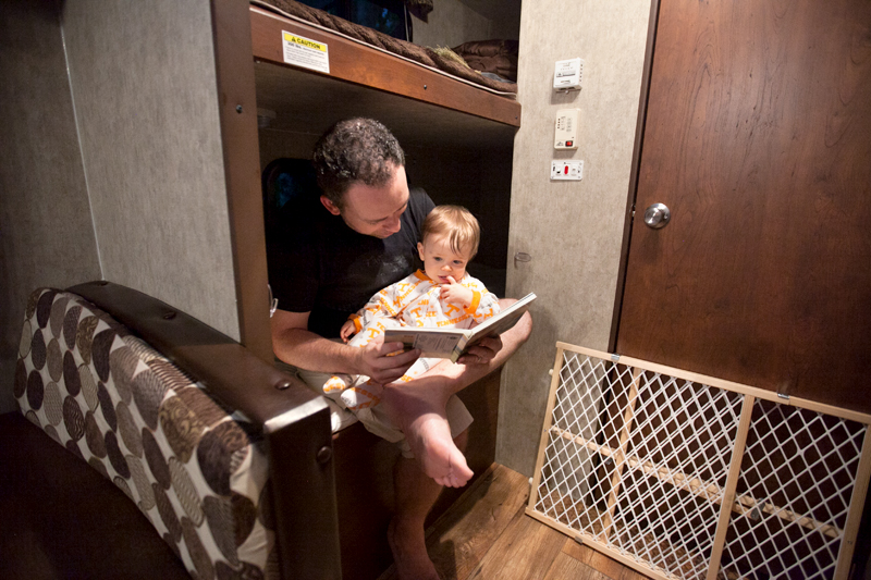 daddy-reading-to-baby-in-camper