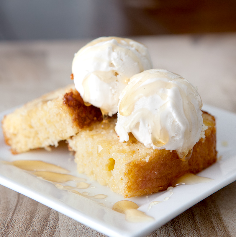Cornbread cake with buttermilk ice cream - this unique and insanely delicious dessert starts with a cake-like sweet cornbread cake that is topped with a tangy homemade buttermilk ice cream and a drizzle of honey. It is SO good!!