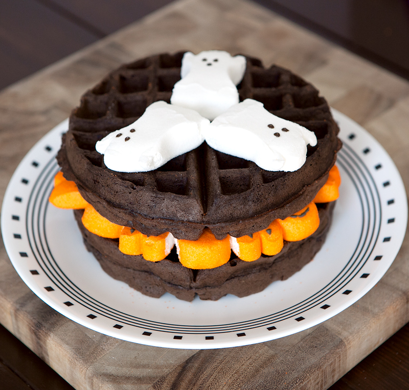 Dark Chocolate Marshmallow Halloween Waffles - these sinful waffles have whipped egg whites folded into the batter to keep them light. They're not too sweet and the sugary melted Peeps marshmallows add just enough sweetness to balance out the bold dark chocolate. Plus, they are SO cute for Halloween or any holiday (just use seasonal Peeps!)