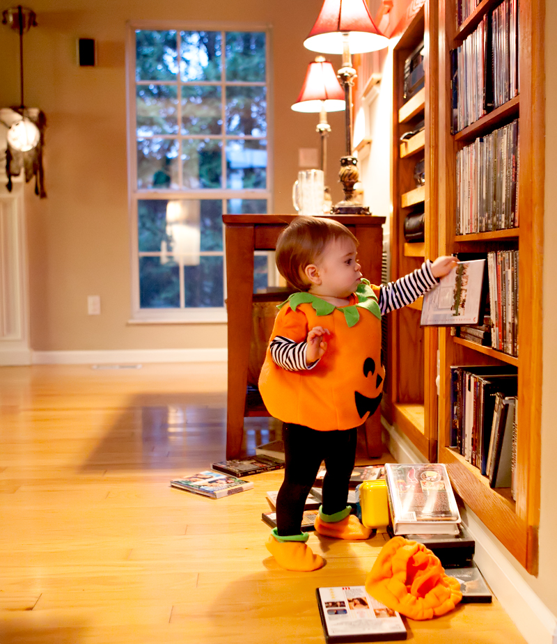 baby-taking-dvds-off-of-shelves