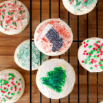 Christmas cookies! Soft, pillowy sugar cookies covered in vanilla bean frosting - reminiscent of Lofthouse cookies you find in the grocery store.