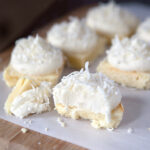 Soft lemon bars frosted with a marshmallow fluff coconut frosting. Seriously one of the best desserts I've ever made.
