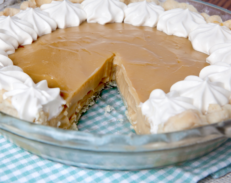 Silky smooth butterscotch pie topped with whipped cream made with Bailey's Irish Cream.
