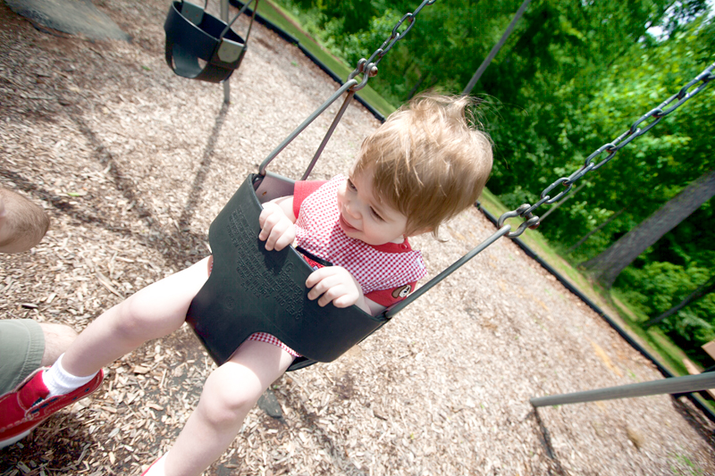 baby in a toddler bucket swing