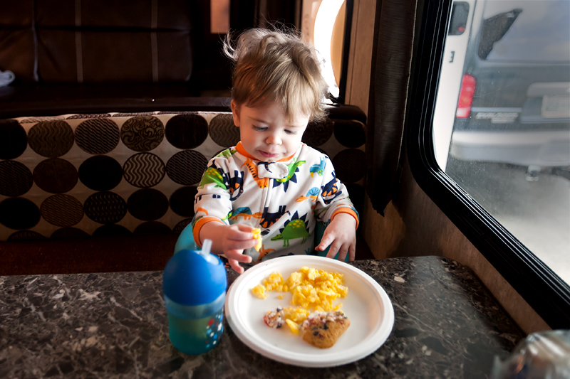 baby with bed hair eating breakfast