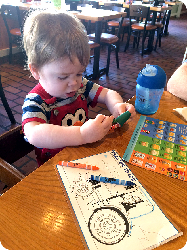 baby-playing-with-menu-at-chilis