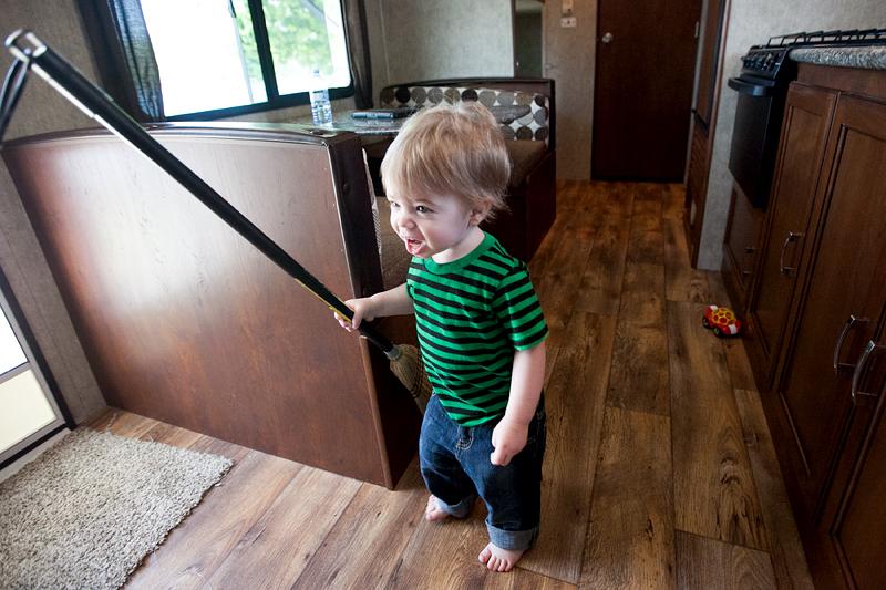 baby sweeping the floor