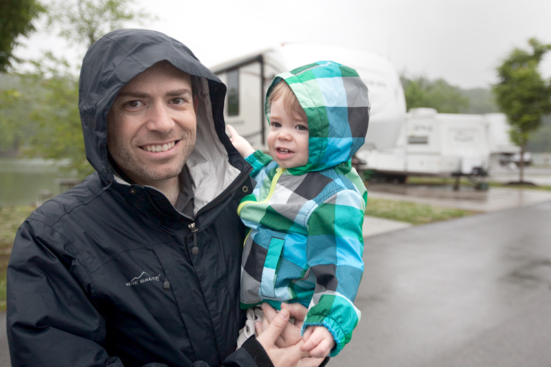 Daddy and baby wearing raincoats on a soggy day
