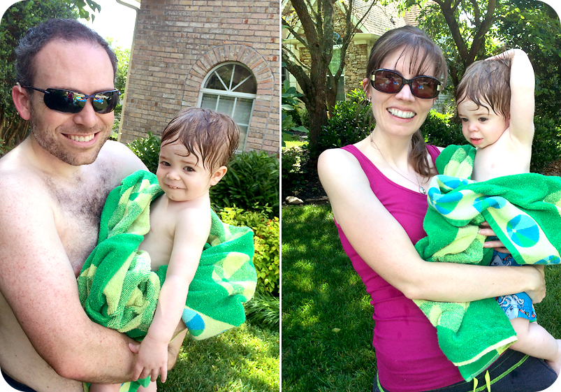 mom-and-dad-holding-toddler-after-pool
