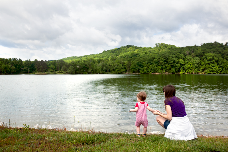 mommy and baby looking at the lake