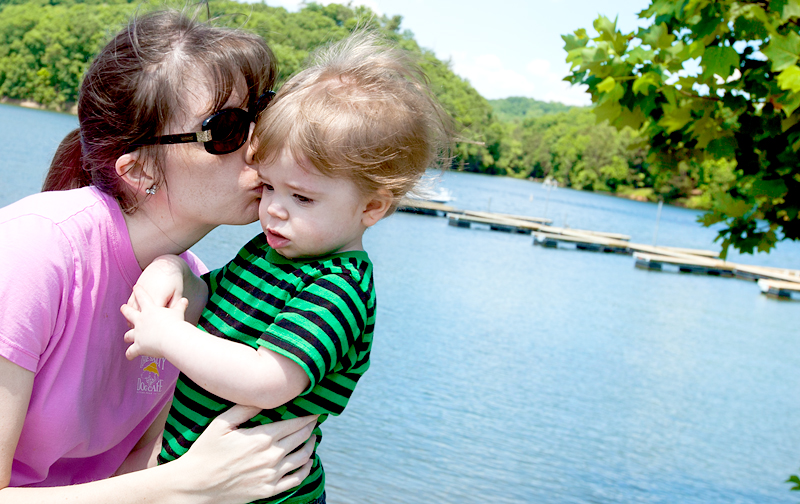 mommy kissing baby at lake