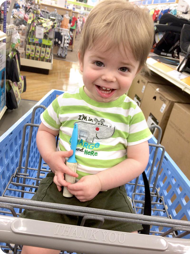 toddler-sitting-in-shopping-cart