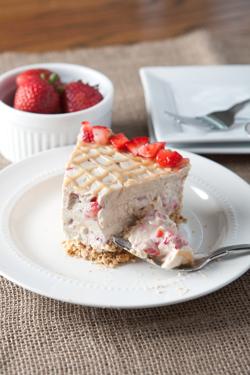 No Bake Peanut Butter Strawberry Fluff Pie is an easy summer treat.  A salty crushed pretzel crust balances the sweetness and the addition of marshmallow creme makes each slice extra smooth and creamy.  Awesome!