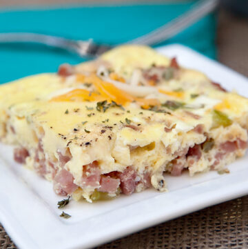 Easy baked breakfast omelet - full of flavorful onions and peppers, cheese, and ham! Fast breakfast idea!