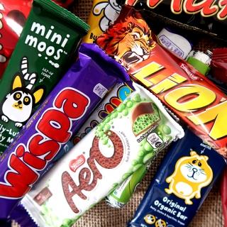 Trying British Candy TASTE TEST! We try all kinds of popular British candy and chocolate like Maltesers, Wispa, Aero, Drifter, Lion, Mars, and more!
