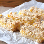 Lemon Oatmeal Crumble Bars - the filling is strong and tart and the crust is soft yet sturdy. The whole thing is finished off with a crunchy crumbly oatmeal topping. These were a hit with everyone I gave them to!!