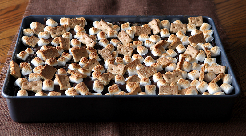 This super moist s'mores cake has a homemade marshmallow frosting mixed right into the batter, with gooey toasted marshmallows and graham cracker pieces on top to finish things off.