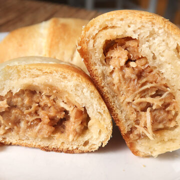 Perfect party food idea or appetizer! Crescent rolls stuffed with shredded chicken mixed with a homemade Thai peanut sauce.