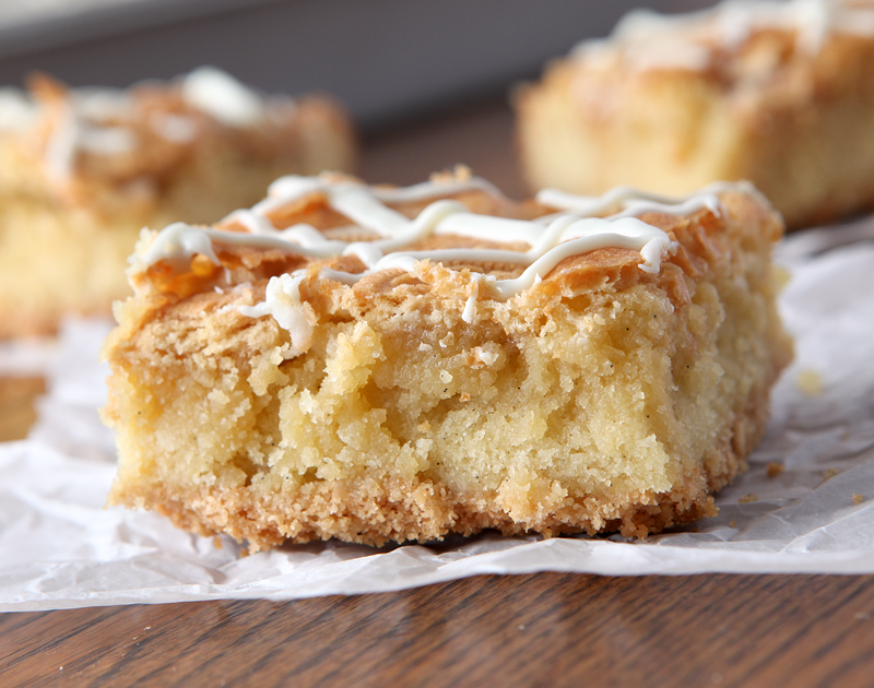 """Vanilla cookie bars for the ULTIMATE """"vanilla person"""". These bars start with a nilla wafer crust that gets topped with a soft blondie layer. Then they get chunks of Golden Oreos and a vanilla drizzle. Yum!"""