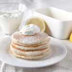 Lemon Ricotta Pancake Topping made from citrus-infused whipped cream - SO GOOD!