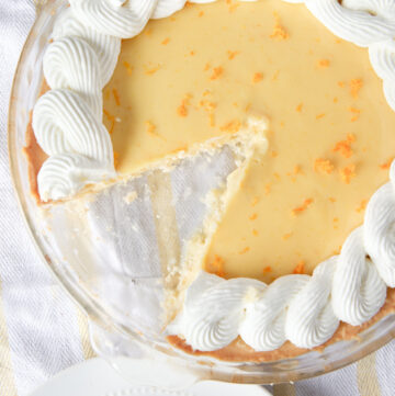 Smooth orange creamsicle pie with the best homemade ginger whipped cream EVER! Omg so good!