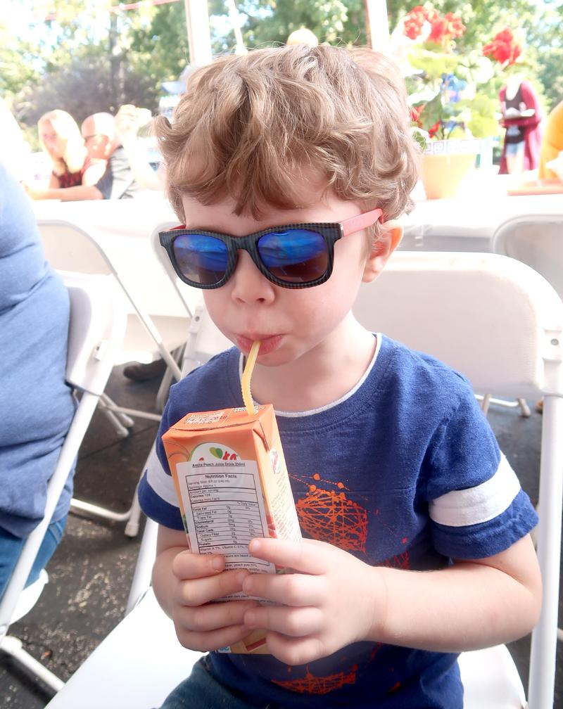 toddler drinking greek juice