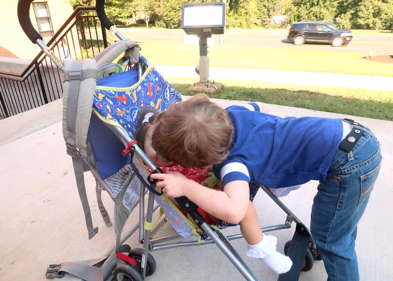 toddler kissing baby