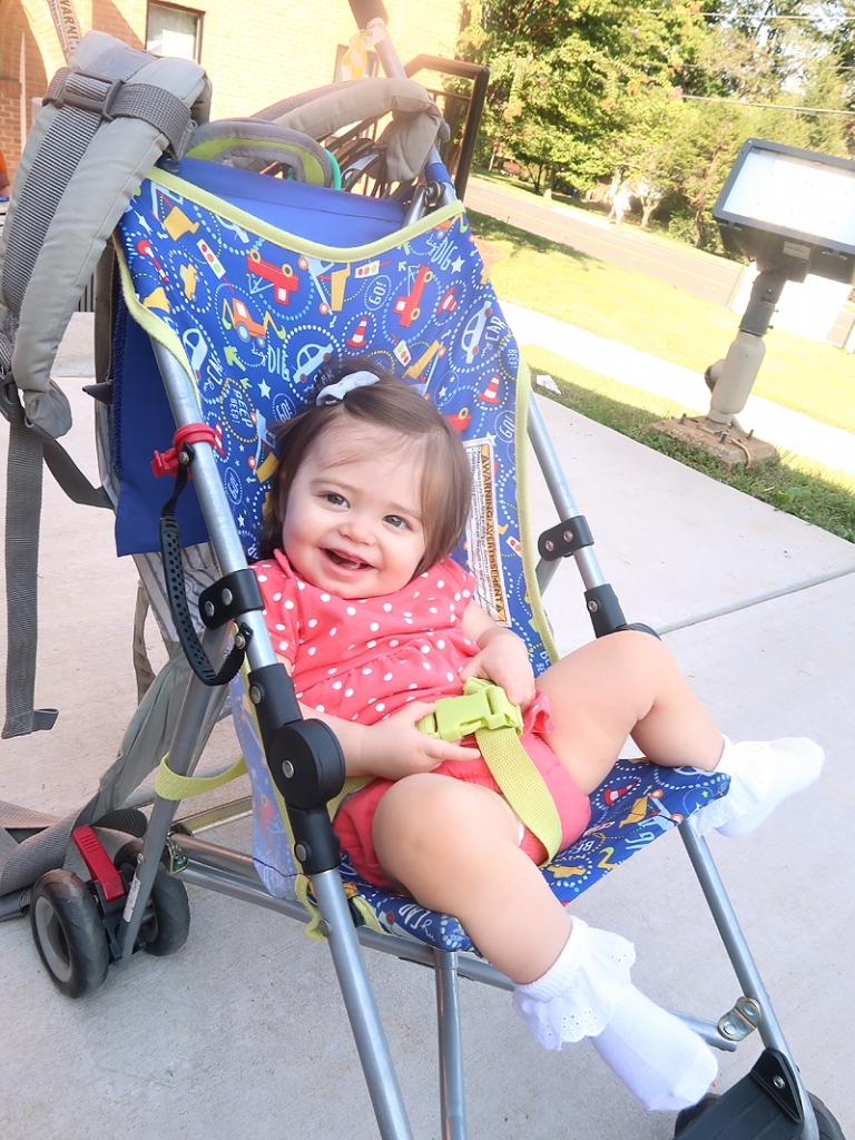 baby in umbrella stroller