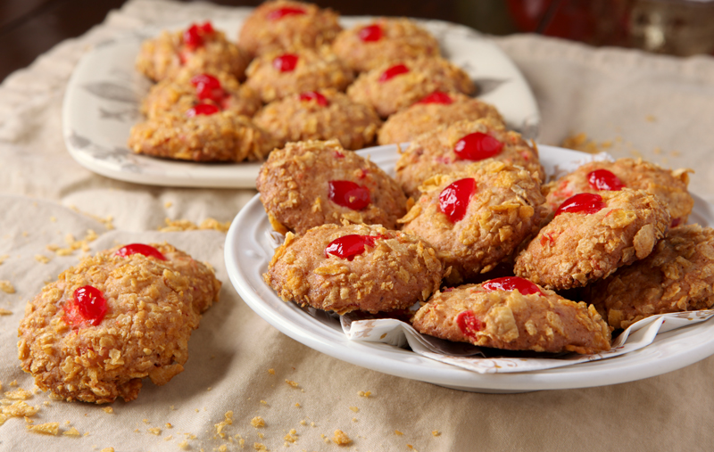 Old Fashioned Cherry Winks cookies rolled in crushed Corn Flakes! There's something so cozy about vintage recipes!