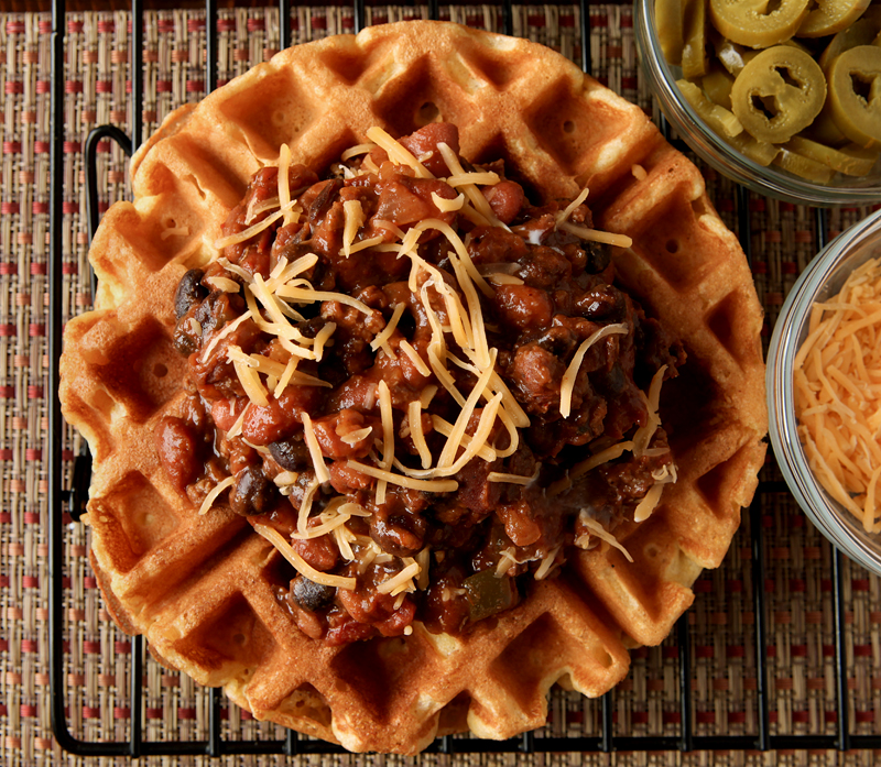 Cornbread Waffles with Three Bean Chili. Perfect cornmeal waffles loaded up with a thick, flavorful three bean and beef chili. Great unique dinner idea!
